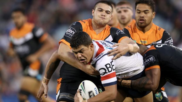 Strong showing: Latrell Mitchell tries to break through a pair of tackles.