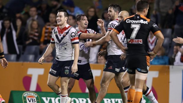 Too easy: Roosters player celebrate after Connor Watson's try.