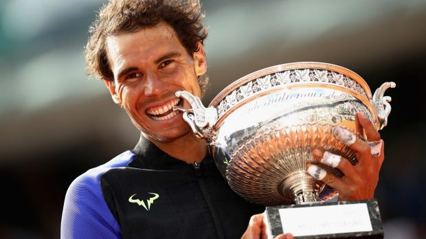 Rafael Nadal is jubilant as he holds the trophy.