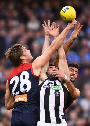 MELBOURNE, AUSTRALIA - JUNE 12: Oscar McDonald of the Demons spoils a mark by Alex Fasolo of the Magpies during the ...