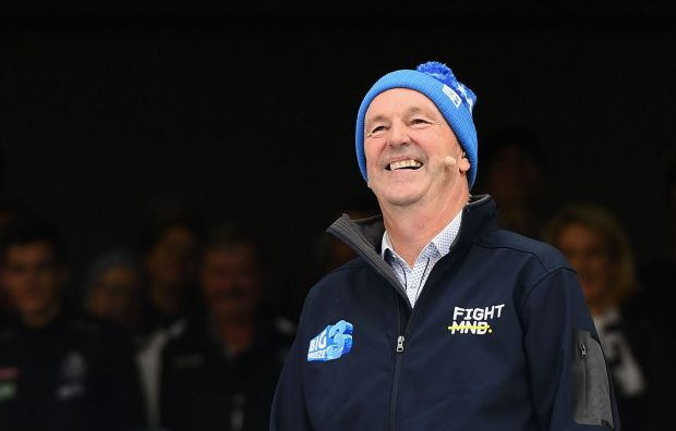 MELBOURNE, AUSTRALIA - JUNE 12: Neale Daniher watches the celebrities go down the Freeze MND slide during the round 12 ...