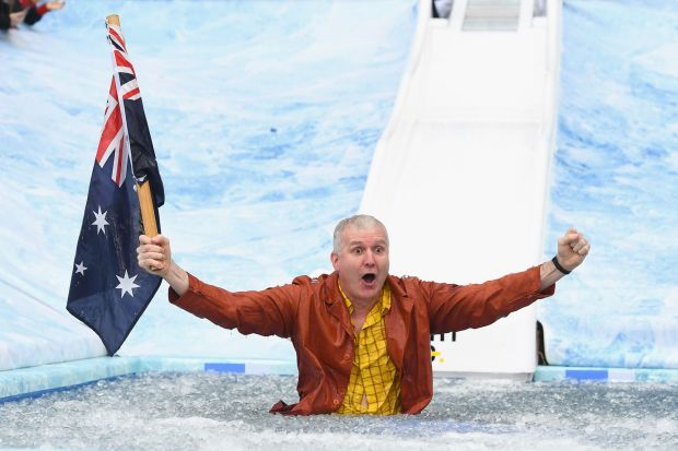 MELBOURNE, AUSTRALIA - JUNE 12: Andrew Gaze goes down the Freeze MND slide during the round 12 AFL match between the ...