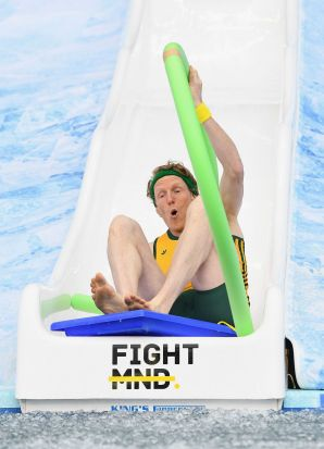 MELBOURNE, AUSTRALIA - JUNE 12: Steve Hooker goes down the Freeze MND slide during the round 12 AFL match between the ...
