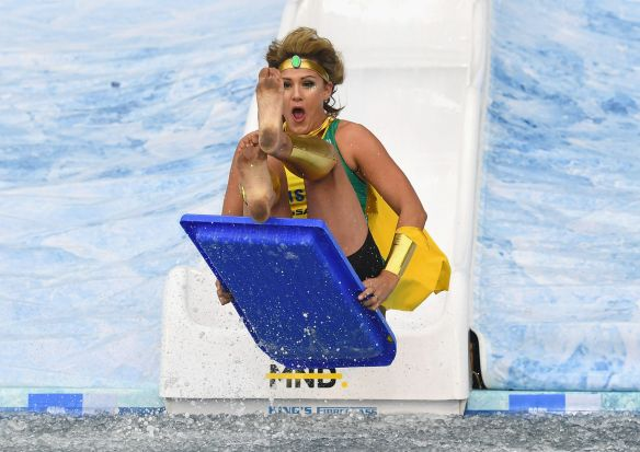 MELBOURNE, AUSTRALIA - JUNE 12: Sharelle McMahon goes down the Freeze MND slide during the round 12 AFL match between ...