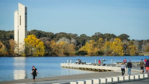 Canberrans soak up the shores of Lake Burley Griffin.