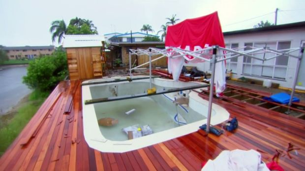 BEFORE: The canal levels were rising at Aaron and Dee's Gold Coast home during the cyclone.