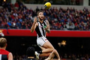 Jeremy Howe of the Magpies marks the ball over Tom McDonald of the Demons.