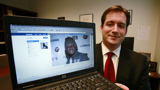 Assistant US Attorney Michael Scoville displays Maxi Sopo's Facebook page.