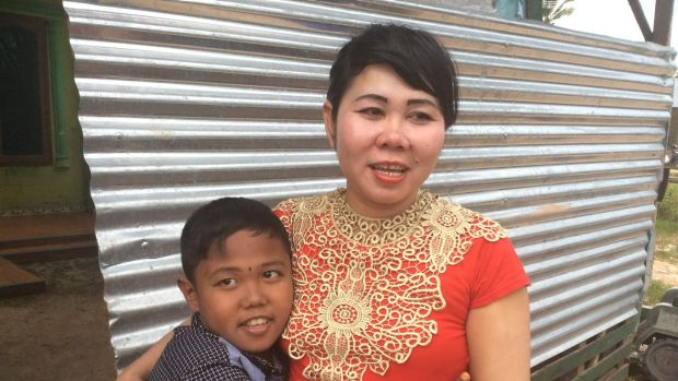 Aldi Rizal with his mother Diana.