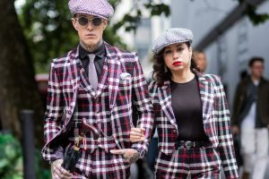 LONDON, ENGLAND - JUNE 12: Couple Jimmy Q and Jet Luna wearing flat cap and checked suits during the London Fashion Week ...