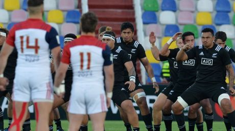 Tense time: The French stare down New Zealand team as they perform the haka.
