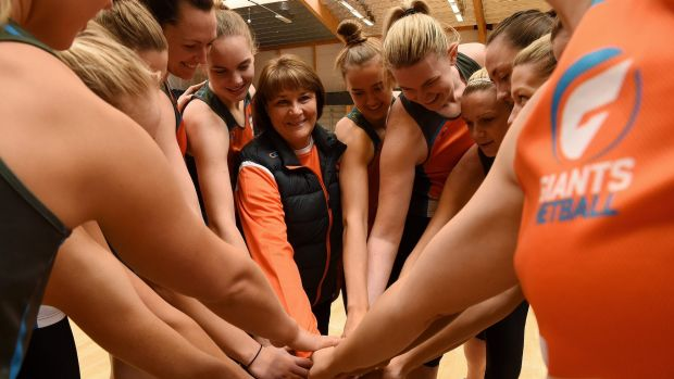 """Eclectic bunch: Giants coach Julie Fitzgerald (centre) and her players have """"clicked from day one""""."""