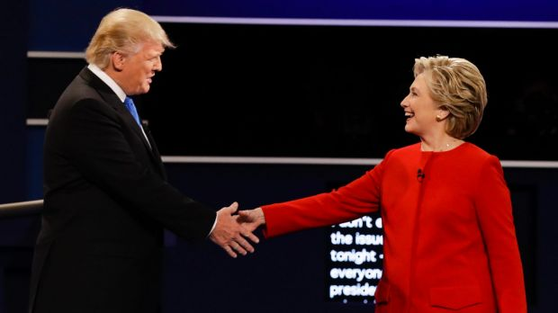 Donald Trump and Democratic presidential nominee Hillary Clinton shake hands during the presidential debate at Hofstra ...