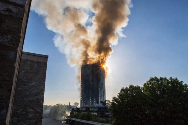 Smoke billows from a high-rise apartment building in west London Wednesday, June 14, 2017. A massive fire raced through ...
