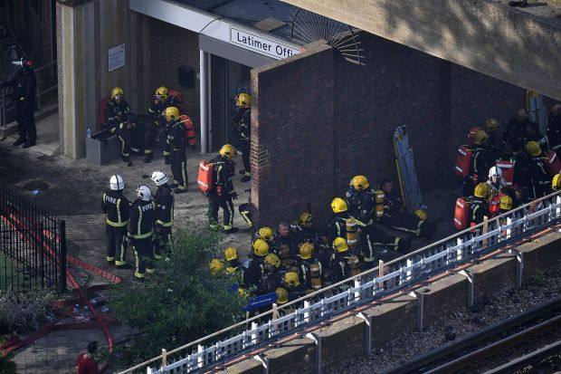 Firefighters outside Grenfell Tower in West London.