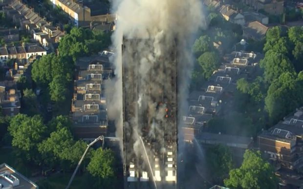 In this photo taken from video, smoke rises from a high-rise apartment building on fire in London, Wednesday, June 14, 2017.