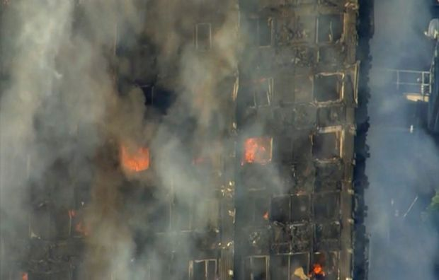 A massive fire raced through the 27-storey high-rise apartment building in west London early Wednesday, sending at least ...