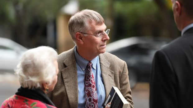 Scott Johnson's partner Michael Noone leaving the court after giving evidence to the inquest.