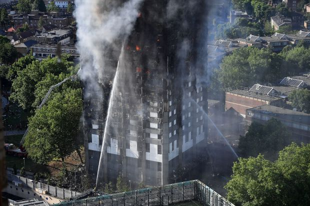 Firefighters tackle the building after a huge fire engulfed the 24-storey Grenfell Tower in Latimer Road, West London.