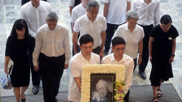 PM Lee Hsien Loong, centre, with siblings Lee Hsien Yang, second from left, and Lee Wei Ling, far right, at their father ...