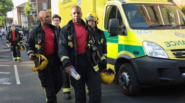 A fire crew near the 24-storey residential Grenfell Tower block. Some 200 firefighters and 40 engines were sent to the scene.