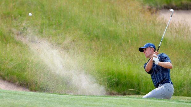 Sandy lie: Jordan Spieth hits out from one of Erin Hills' notorious bunkers during a practice round.