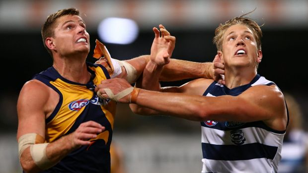 Eagle Nathan Vardy and Rhys Stanley of the Cats contest the ruck on Thursday night.