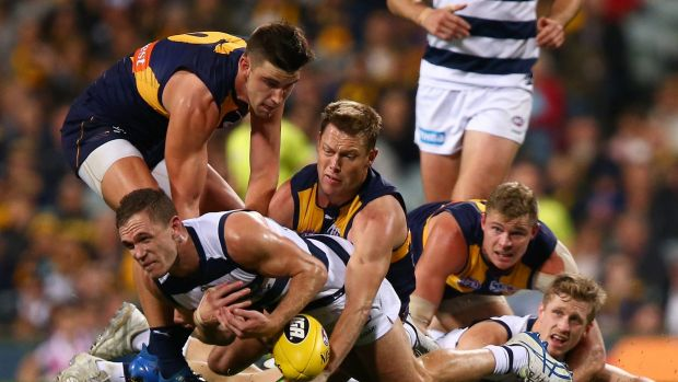 Sam MItchell tackles Joel Selwood at Domain Stadium on Thursday night.