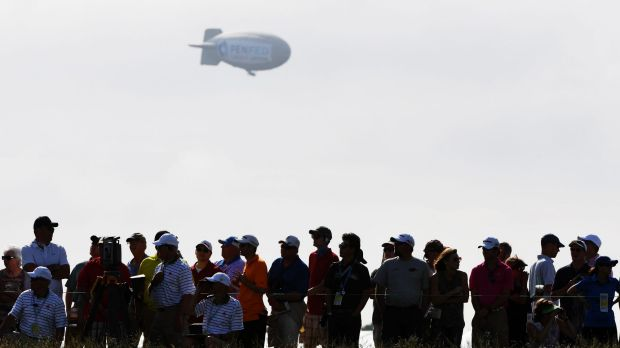 The blimp floats over the crowd earlier in the day.