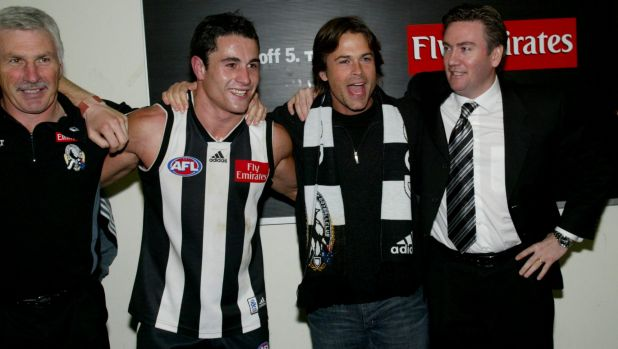 Actor Rob Lowe and Collingwood president Eddie McGuire sing the song with coach Mick Malthouse and Paul Licuria in 2003.