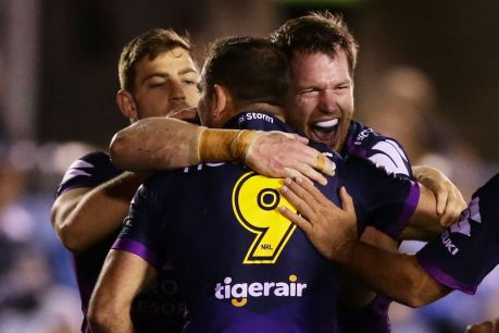 SYDNEY, AUSTRALIA - JUNE 08: Tim Glasby of the Storm celebrates with team mates after scoring a try during the round 14 ...