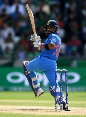 Captain's knock: Virat Kohli crunched an unbeaten 96 off 78 balls against Bangladesh to guide India into the Champions ...