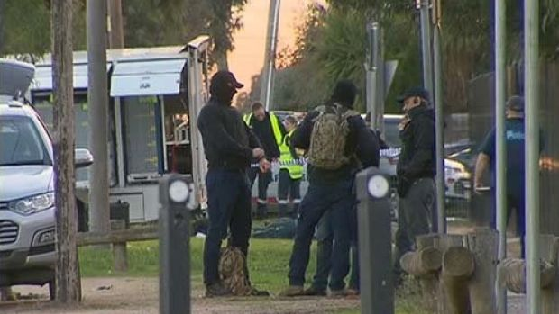 Police negotiating with armed man at Melbourne home