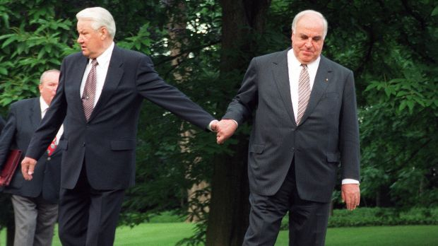 German Chancellor Helmut Kohl, right, guiding Russian President Boris Yeltsin through the park after Yeltsin's arrival ...