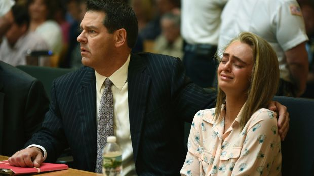 Michelle Carter, seated beside her attorney Joseph Cataldo, reacts as Judge Lawrence Moniz finds her guilty of ...