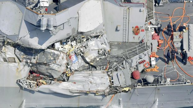 The damage on the starboard side of the USS Fitzgerald is seen off the Japanese coast.