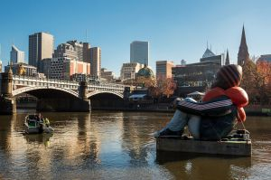 Artwork called Inflatable Refugee, pictured on the Yarra River on Saturday, is touring the globe to highlight the plight ...