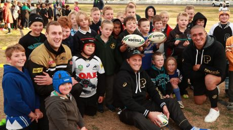 Spreading the word: Penrith players Isaah Yeo, Matt Moylan and Leilani Latu (far right) with children at a recent ...