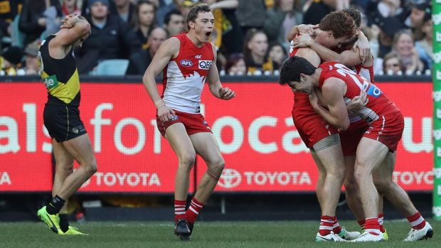 The Swans converge on Gary Rohan after he sealed the win against Richmond at the MCG.