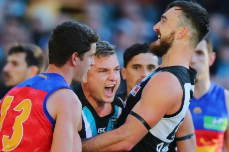 Port's Ollie Wines (centre) celebrates a goal with teammate Justin Westhoff.