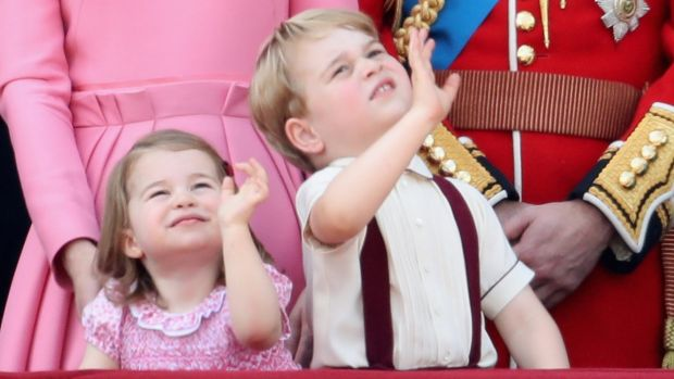 Princess Charlotte and Prince George wave from the balcony of Buckingham Palace.
