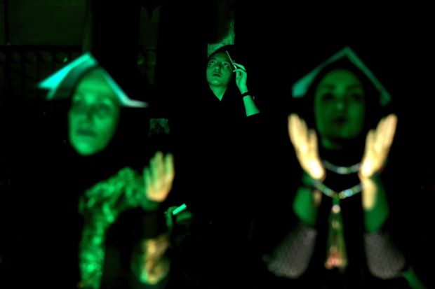 Iranian Shiite Muslims place copies of Quran, Islam's holy book, on their heads while praying in Laylat al-Qadr, or the ...