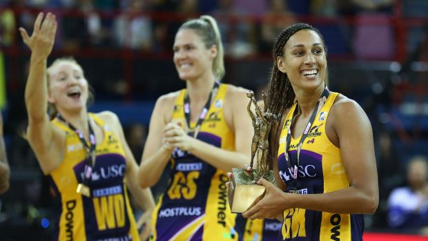 Winning combination: Lightning captain Geva Mentor holds the Super Netball trophy