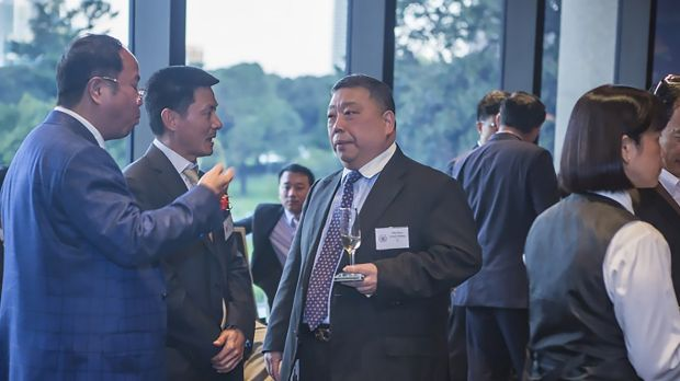 Huang Xiangmo (far left) and NSW MLC Ernest Wong at the 2014 unveiling of an Australian Guangdong Chamber of Commerce ...