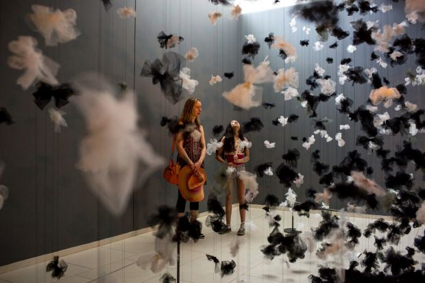 Sonia Srichai, left, and her daughter Simone look at The Space in Between art piece at the American Swedish Institute ...