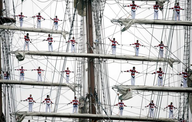 Sailors man the rigging on the Peruvian Navy tall ship Union during Sail Boston's Parade of Sail, Saturday, June 17, ...