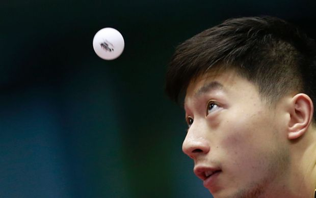 Ma Long of China serves against Fan Zhendong of China during their men's final match of the Japan Open table tennis ...