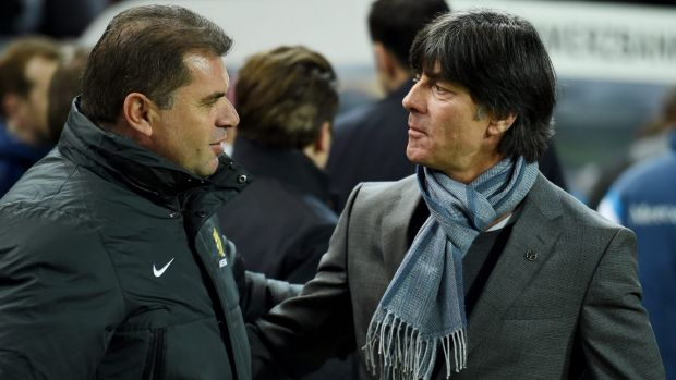 Ange Postecoglou greeted by Joachim Loew of Germany during an international friendly in 2015.