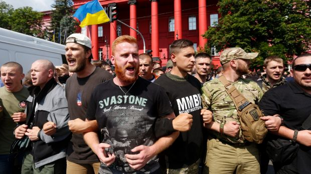 Ukrainian ultra nationalist activists shout slogans as they protest against the annual Gay Pride parade.