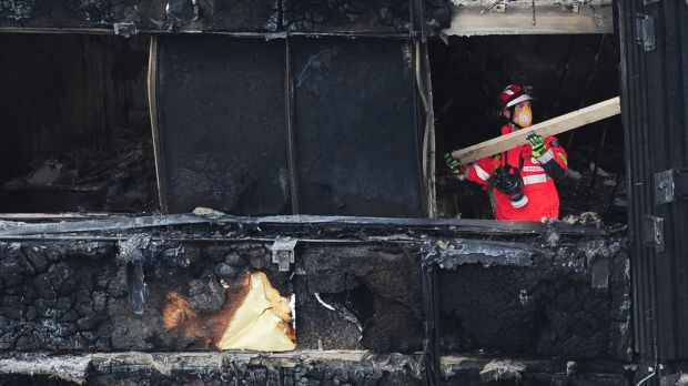 A London Fire Brigade officer inside the charred Grenfell Tower.